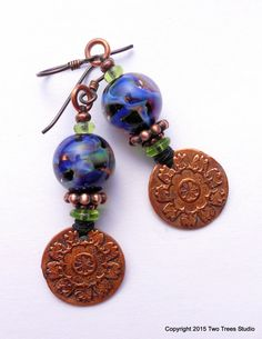 This Blue World: Beautiful swirls of color and and textured copper come together in gorgeous earrings. By Two Trees Studio on Etsy.