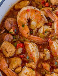 Easy Jambalaya made with Chicken, Shrimp and Andouille Sausage in under 45 minutes. Served over rice or rice cooked with the jambalaya for one pot meal. Creole Recipes, Cajun Recipes, Seafood Recipes, Chicken Recipes, Donut Recipes, Calamari Recipes, Pork Recipes, Fish Recipes, Healthy Recipes