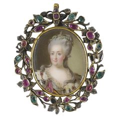 RUSSIAN SCHOOL 18TH CENTURY PORTRAIT OF CATHERINE II 'THE GREAT', EMPRESS OF RUSSIA (1729-1796) with small diamond crown and laurel wreath on her powdered and curled hair, wearing an ermine cape with the chain of the Order of St. Andrew and the sash of the Order of St. George enamel, held in a silver and gold openwork frame of leaves and flowers set with emeralds, rubies and diamonds. Sotheby's