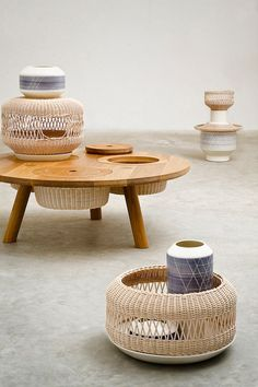 is a table with components that range from lampshades, bowls, wicker baskets, and ceramic vases, all of which are their own separate entities but when assembled together, they form a cohesive unit.