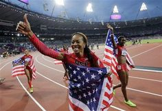 United States' Deedee Trotter, right, United States' Sanya Richards-Ross, front center and United States' Allyson Felix, back left, celebrate winning gold in the women's 4x400-meter relay final during the athletics in the Olympic Stadium at the 2012 Summer Olympics, London, Saturday, Aug. 11, 2012. (AP Photo/David J. Phillip )