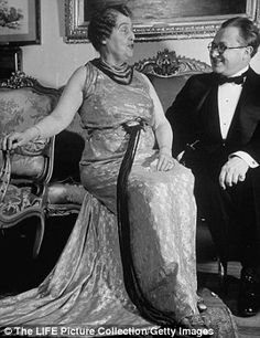 Florence is pictured talking to an unidentified guest at her home in 1937