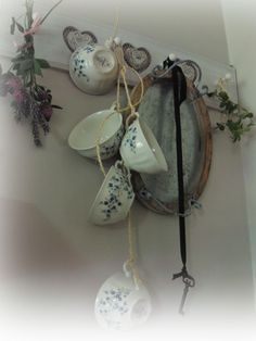 tea cups hung up with a string.  I'm going to do this TODAY.  How sweet.