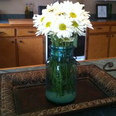 Blue glass mason jar and flowers on an iron tray!