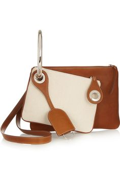Tan leather (Calf), ivory canvas Zip fastenings along top Comes with dust bag Weighs approximately 3.5lbs/ 1.6kg