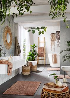 boho Bathroom Decor a contemporary meets boho space with potted greenery, baskets, rattan furniture, a wicker mirror and a ladder Bohemian Bathroom, Bohemian Bedroom Decor, Decor Room, Tropical Bathroom Decor, Boho Chic Interior, Green Bathroom Decor, Wooden Bathroom Accessories, Garden Bathroom, Boho Chic Living Room