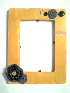wooden frame - 50 cents at WalMart  golden-yellow paint, scraps of fabric, buttons and twine. Quick and easy gifts