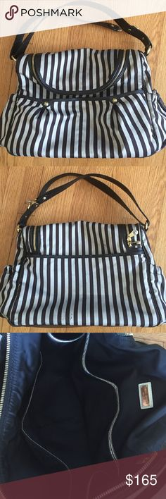 """Henri Bendel bag.  Striped large bag, in good condition.  Side pouches, large outer pouch and outer double pouch.  Zip close,. A great bag with many compartments for your things.  Adjustable leather strap.  Measures 16"""" X 12"""", roomy. henri bendel Bags"""
