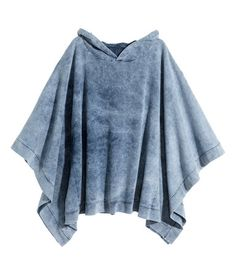 Poncho in sweatshirt fabric with a light blue, washed denim look. | H&M Pastels
