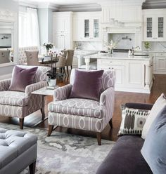 Purple and grey living room.  Love the kitchen too!  Gallerie B