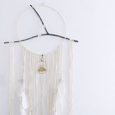 Large White Spirit Dream Circle by Torchlight Jewelry / Handmade with deerskin leather, white turkey feathers and selenite wand / Handcrafted in Santa Barbara, California / Made for Bri Emery of Design Love Fest