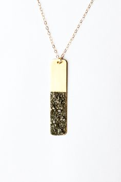 Long gold necklace - gold bar necklace - pyrite necklace - pyrite jewelry - gold jewelry - black gemstone necklace - metallic necklace. $54.00, via Etsy.