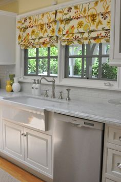 Attractive This Roman Shade In Tropical Colors Punches Up A Classic White Kitchen.