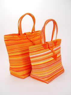 Senegal Sunrise Tote Bag. Grocery shopping just got brighter with this stripe-happy tote bag.   These versatile, hand-woven bags are great for trips to the beach or picnics in the park. Use it as a decorative shopping bag or to tote your schoolbooks. Each tote bag is made from a traditional, West African basket weave, and gives you bohemian chic style.These bags are colorful, durable, versatile and created by a team of young apprentices in Dakar.  $22.00.  Artist: Mamadou Kieta  Made in…