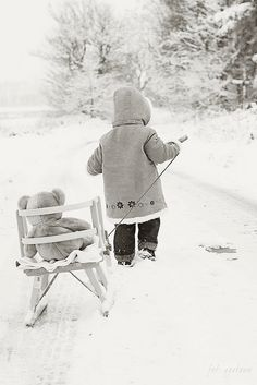 Child and snow buddy.