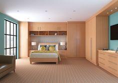 nice! bedroom w maple furniture. w cream instead of teal walls.