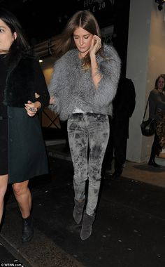 Making her exit: Millie held onto a pal's arm as she made her way out of the fashion week bash