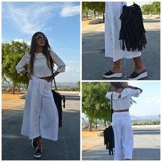 """Nahir Randazzo elige pantalones Culotte de Zaraque de rebajas Un look """"total white"""", con crop top de H&M para alargar la silueta y que marque la cintura, combinado con unas sandalias negras de Zara, un bolso negro de flecos también de Mamb."""