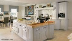 Classic white kitchen with marble and wood worktop