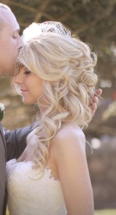 Beautiful, elegant, timeless wedding hair.  Loose curls to the side.  Hair Done by me!