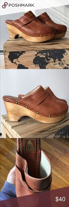 NWT Aldo brown leather stud clogs/mules READ BELOW Never worn! Just stored away in my closet. Weren't stored in box so one is a little smooshed as seen in the picture but you can't even tell once they're on. Leather (not sure if real or not but certainly looks it), studs and a wood base. Shoe says 8 1/2 US but they do not fit like an 8 1/2.. run very small. More like a 7. Aldo Shoes Mules & Clogs