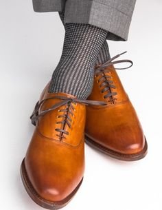 These grenadine men's black and ash dress socks are made with an exceptionally soft mercerized cotton. Expertly knitted at a third-generation North Carolina mill, these fashionable socks are a timeles