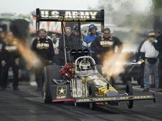 top fuel dragster - my type of race 0 to 100 in 0.7 seconds and hit nearly 300 MPH in less than a 1/4 mile - 2 seconds later the race is over...