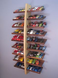 Hot Wheels shelving! Why hide them? Display and organize them in his room or play area, for quick access. (DIY)  - we have far too many matchbox cars for this to work for our little guy's room.  Nice idea though. I think this would be great for a collector of unique/collectible ones. My Dad has a few handfuls that are cool enough to deserve a display in the man cave.