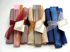 Montaje foulard hilo liso surtido en distintos colores y abanico.