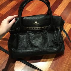 Kate Spade black pebbled leather cross body Used three times, in perfect condition. No staining, rips or tears on outside or inside. Has zippered pocket on flap and roomy inside with good organizational pockets. Has a detachable strap to make it a cross body. Also can carry comfortably on arm with the top handles. Merchandise number: WKRU1874 kate spade Bags Crossbody Bags