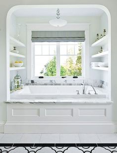 arched alcove bath with shelves by clare