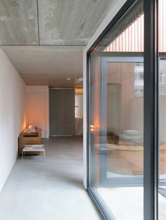clean white walls, screed floor, no skirtings, I like it. Wooden Houses by M3H Architecten
