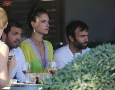 Alessandra Ambrosio is spotted dining with her family while on holiday in Mykonos Island, Greece. August 12, 2015