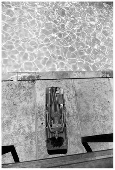 Woman sunbathing beside the pool, seen from above, 1975  Photo Garry Winogrand