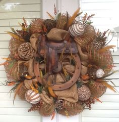 Saddle and Wagon Wheel Burlap Wreath. $155.00, via Etsy.