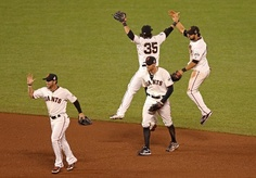 Gregor Blanco #7, Brandon Crawford #35, Hunter Pence #8 and Angel Pagan #16 of the San Francisco Giants celebrate after they won 2-0 against the Detroit Tigers during Game Two of the Major League Baseball World Series at AT & T Park on October 25, 2012 in San Francisco, California