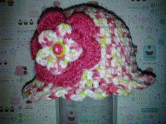 Newborn Ruffle Hat with Flower. $12.50, via Etsy.
