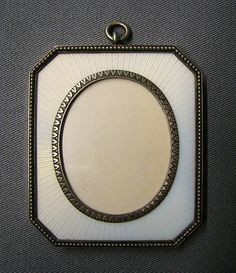Picture frame by Carl Fabergé, workmaster: Henrik Emanuel Wigström, 1908–17, in silver and guilloche enamel