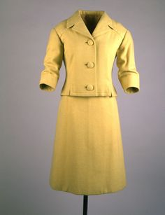 "Yellow Suit Maker: Oleg Cassini (American, b. France, 1913-2006) Date(s) of Materials: 1961 Place Made: United States Medium: Wool Dimensions: Jacket: 22"" center back; Skirt: 25"" center back Description: A two piece suit of pale yellow wool with a three button collar jacket and an A-line skirt. Historical Note: This suit was worn as part of an ensemble by First Lady Jacqueline Kennedy during her first State Visit to Ottawa, Canada on May 17, 1961."