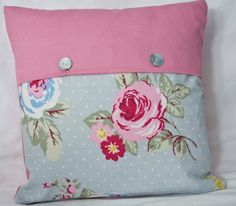 14 inch Cushion/Throw Pillow  made in English Rose Shabby Chic Fabric &  Plain Pink Fabric Back with Mother of Pearl Buttons. $14.00, via Etsy.