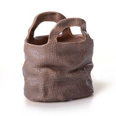 http://www.achica.fr/product/2349367/pot-de-fleurs-sac-en-porcelaine-13-x-8-5-x-13-5-cm-fini-naturel
