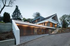 """Architecture designs - The property is located in the Taunus on a southern slope, the """"Peterlingswiesen"""". It is above a st - Modern Farmhouse Exterior, Farmhouse Plans, House Built Into Hill, Hillside House, Facade Architecture, Modern House Design, Exterior Design, Future House, Building A House"""