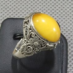 Floral filigree silver work on a Baltic egg yolk amber ring. Plunder Jewelry, Filigree Jewelry, Emerald Jewelry, Silver Filigree, Copper Jewelry, Cute Jewelry, Jewelry Art, Jewelry Gifts, Jewelery