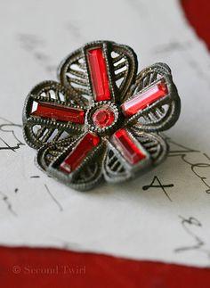 Antique Steel Cut Button w/Red Rhinestones.