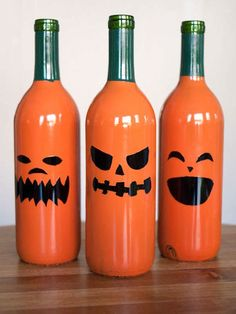Halloween + drinking = wine bottle jack-o-lanterns! Turn regular cheap wine bottles into some funky Halloween decorations. Halloween decorations that you can drink! Even better. This Instructable was brought to you by Krylon Reuse Wine Bottles, Wine Bottle Crafts, Bottle Art, Beer Bottles, Empty Bottles, Bottle Painting, Glass Bottles, Paint Wine Bottles, Bottle Torch