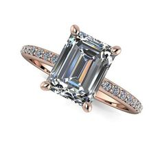 SUPERNOVA Colorless Moissanite emerald cut engagement ring featuring a 1.90 ct emerald cut stone and accented with 22 diamonds, F/G VS quality, .18 ct. Shank Width: 1.8mm SUPERNOVA colorless moissanit