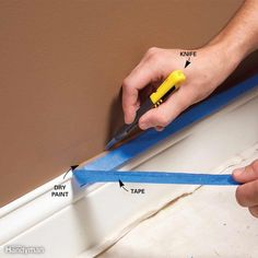 Once paint is dry, you can't just pull the tape off the trim. Paint forms a film between the wall and the tape, and removing the tape tears pieces of dried paint off the wall. So before pulling off the tape, cut it loose. Wait for the paint to completely dry at least 24 hours, then use a sharp utility knife or box cutter knife to slice through the film. Start in an inconspicuous area to make sure the paint is hard enough to slice cleanly. If you cut the paint while it's still gummy, you'll…