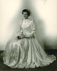 Bridal portrait of Miss Millicent Hill, 1950. Her dress was a gift from the grateful people of Lyon, France, who wanted a bride of an American WWII veteran to have the gown in appreciation of the US troops. She was selected from dozens of candidates. Miss Hill married infantry sergeant Theodore Dudley,who served in France and Belgium during WWII.