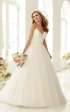 This embroidered Lace on tulle princess silhouette wedding gown from the Stella York bridal gown collection features stunning details like a sexy v-neck, spaghetti straps, a chapel train, and a detachable Diamante beaded waist sash.