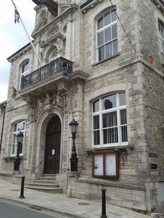 Swanage Town Hall has as its central feature the London Mercer's Hall doorway and windows relocated from London by George Burt of Mowlem's c1880